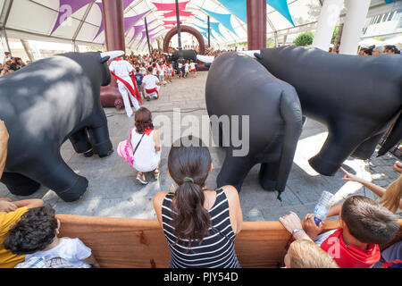 Montijo, Spain - September the 7th, 2018: Running of the bulls for children. Party for children with inflatable bullfights - Stock Image
