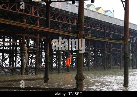 Hastings, East Sussex, UK. 06 Apr, 2019. Volunteers from all over the country come together at the beginning of April to clean a beach near you. This year, volunteers from hastings and surrounding areas meet at the Hastings pier from 10.30am. People of all backgrounds are encouraged to come down and spend some time cleaning the beach of mainly plastic pollution. The pier's columns covered in fishing net and rope. ©Paul Lawrenson 2019, Photo Credit: Paul Lawrenson/Alamy Live News - Stock Image