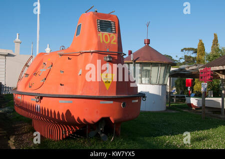 Moulded plastic lifeboat and other displays at the Maritime Museum in  historic Port Albert on the Bass Strait coast, - Stock Image