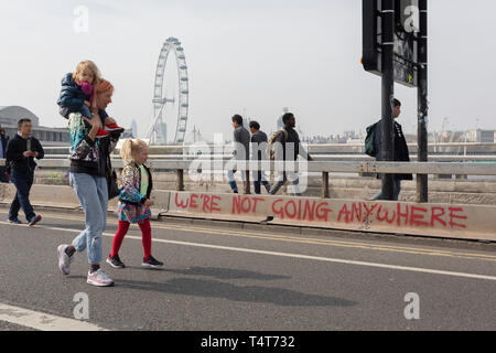 Commuters and visitors walk across the closed Waterloo Bridge on day 4 of protests by climate change environmental activists with pressure group Extinction Rebellion, on18th April 2019, in London, England. - Stock Image