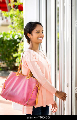 Young beautiful hispanic woman smiling. - Stock Image