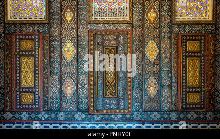 Floral ornaments of wooden embedded cupboards painted with colored geometrical patterns, Syrian hall of historic Manial palace of Prince Mohammed Ali - Stock Image