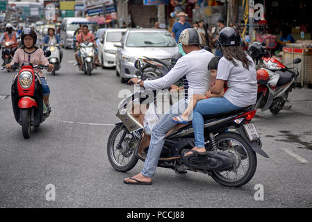Family, including child, using motorcycle transport. Thailand Southeast Asia - Stock Image