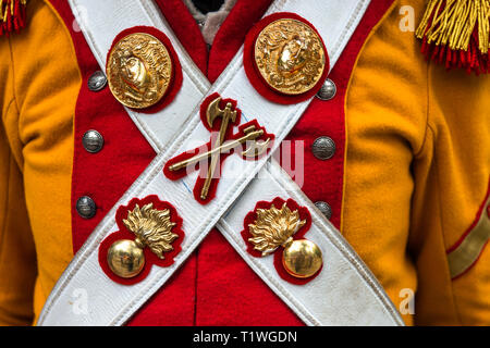 MOSCOW, AUGUST 16, 2018. Details of a military uniform of Napoleon army. Ensigns on leather belts across the yellow and red coat. International Times  - Stock Image