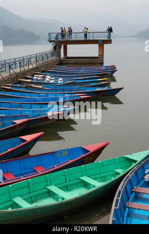 Colourful rowboats for hire, Phewa Lake, Pokhara, Nepal. - Stock Image