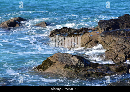 A calm sea with rocks - Stock Image