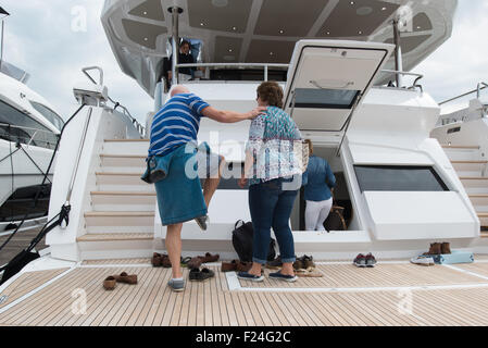 Southampton, UK. 11th September 2015. Southampton Boat Show 2015. Show visitors remove their shoes before boarding - Stock Image