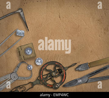 vintage jeweler tools and diamonds over  working bench, blank space for your text - Stock Image