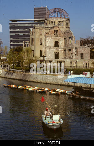 Two men in a boat next the the A-bomb site in Hiroshima, Japan. - Stock Image