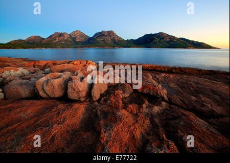 Rocky shoreline Freycinet Peninsula TAS Australia - Stock Image