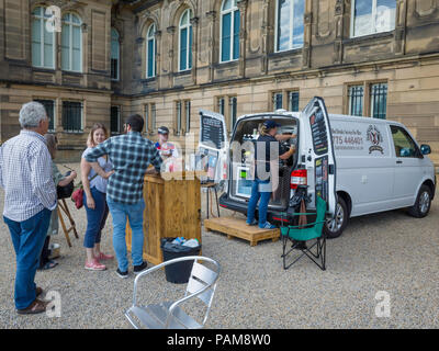 People waiting to be served at a mobile hot drinks van outside a museum - Stock Image