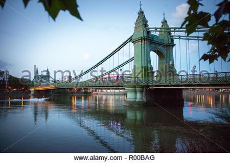 Hammersmith Bridge at sunset in Hammersmith, London - Stock Image