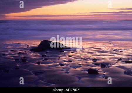 Sunset at Ocean Beach below Fort Funston, San Francisco, California, USA - Stock Image