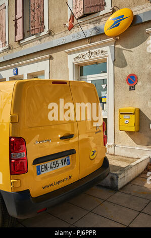 Yellow post office van outside a post office building, Ardeche region, France - Stock Image