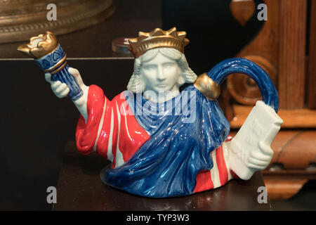 A teapot shaped like the Statue of Liberty is among the artifacts in the new Statue of Liberty Museum that opened on Liberty Island on May 16, 2019. - Stock Image