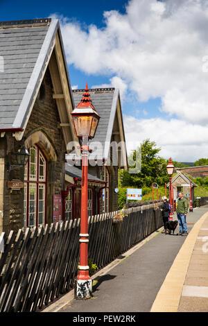 UK, Cumbria, Dentdale, Cowgill, Dent Station on Settle to Carlisle railway line, visitors on platform - Stock Image