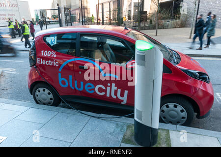 An electric Bolloré Bluecar of the  BlueCity Car Sharing scheme being charged at a charging point in central London. - Stock Image