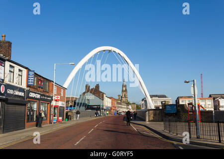 Bolton white gateway arch on Newport Street, Bolton, near the railway station, looking north towards the town hall. - Stock Image