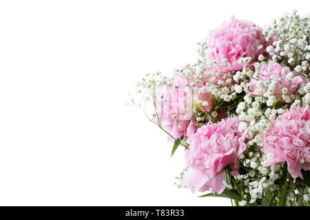 Pink flowering bouquet of Peonies and Baby's Breath flowers over a white background  with free space for your text. - Stock Image