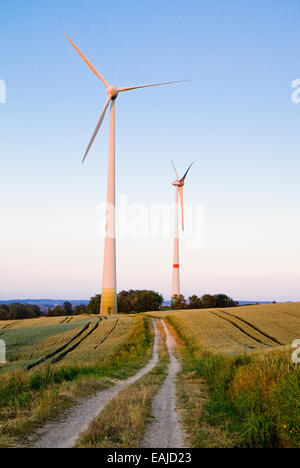 Windmills at dusk, an renewable energy source - Stock Image