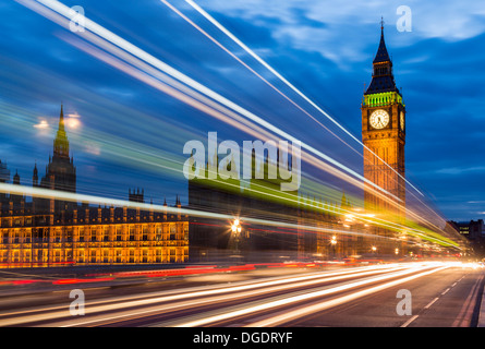 Streaks from buses Westminster Bridge and Houses of Parliament at night England - Stock Image