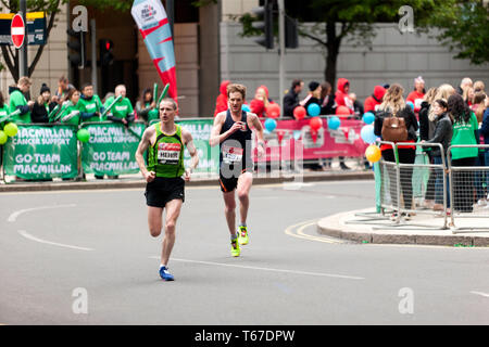 John Gilbert (Kent AC),  competing in the 2019 London Marathon. John finished 2nd in his category, in  a time of 02:19:03.  Sean Hehir  (IRL), finished 31st in the Mans Elite Category, in a time of  02:18:58. - Stock Image