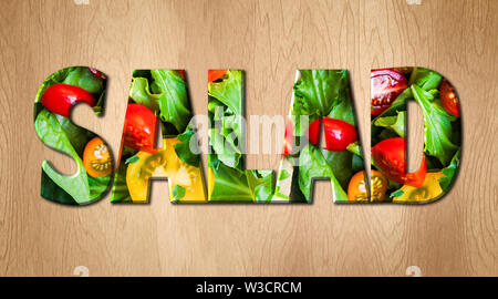 Salad word covered with various vegetables on a kitchen cutting board - Stock Image