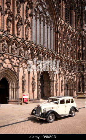 Wolsley vintage white wedding car at west front of Lichfield Cathedral Staffordshire England - Stock Image