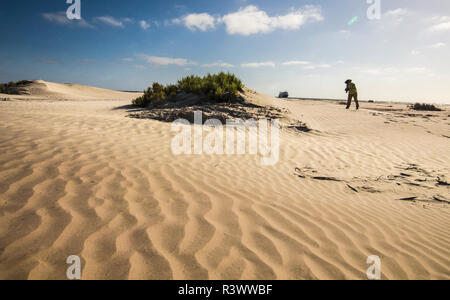 Mexico. Baja, Gulf of California, Magdalena Beach. Photographer taking Pictures on Sand dunes. - Stock Image