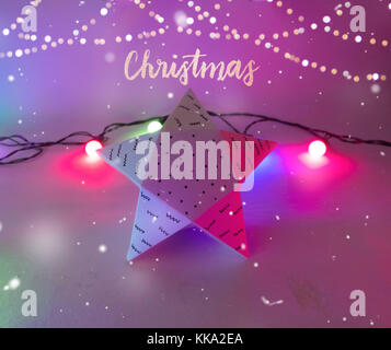 Christmas Decoration with star gift  box with golden bokeh and christmas lights for holidays best background image - Stock Image