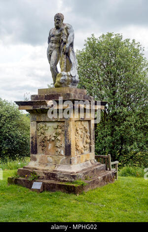 A statue of the Farnese Hercules at Castle Howard Yorkshire UK famous for his huge strength and the 12 Labours he  undertook - Stock Image