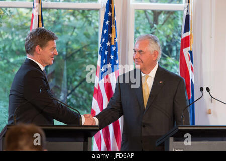 U.S. Secretary of State Rex Tillerson and New Zealander Prime Minister Bill English shake hands after their press - Stock Image