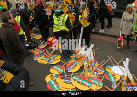 London, UK - 16 March 2019:  Stewards sort out placards on Park Lane ahead of the march. Thousands of people took part in the UN Anti-Racism Day demonstration that took place in central London on 16 March. The demonstration which began in Park Lank and ended outside Downing Street was organised by Stand Up to Racism and Love Music Hate Racism and supported by the TUC and UNISON. Photo: David Mbiyu Credit: david mbiyu/Alamy Live News - Stock Image