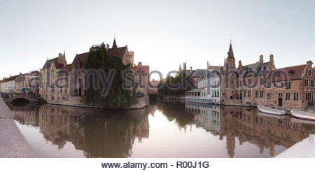 Buildings by bridge in Bruges, Belgium - Stock Image