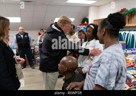 U.S President Donald Trump meets with residents at the Providence Baptist Church relief center March 8, 2019 in Smiths Station, Alabama. The region was hit by a tornado on March 3rd killing 23 people. - Stock Image