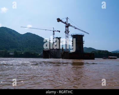 New China Bridge under contruction over mighty Mekong River Prabang Luang Laos constructed by China Railway No.8 Engineering Group Co Ltd when complet - Stock Image