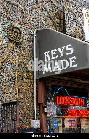 Locksmith shop in Greenwich Village, New York, with facade of metal sculpture made with keys by the owner, Phil - Stock Image