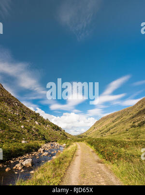 Walking path on a track through Glenveagh National Park, County Donegal, Ireland, on a beautiful August day - Stock Image
