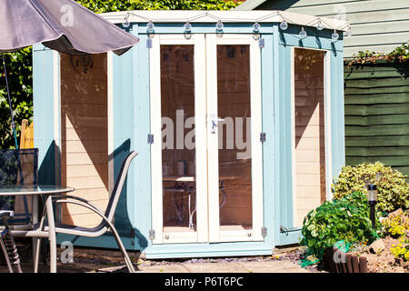 Summer house, Summer house garden UK, Summer house garden, Summer house in garden, summerhouse, UK, table and chairs outside UK, UK summerhouse, UK - Stock Image