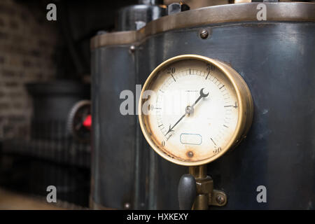 Old industrial pressure gauge. - Stock Image