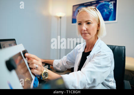 Doctor Woman Working In Hospital Office With Computer Technology Equipment - Stock Image