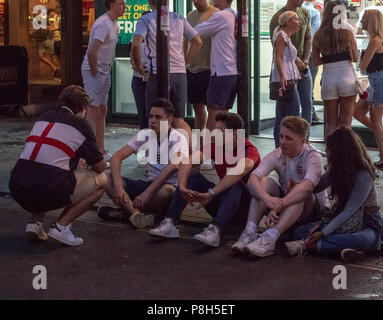 Brentwood, Essex 11th June 2018 Approximately fifty police officers deployed in Brentwood Essex  following England losing against Croatia.  Fans tears turned to disorder and Essex police had to clear fans down the entire length of the High Street.  One small group of fans challenged the police and arrests were made. Credit Ian Davidson/Alamy Live News - Stock Image