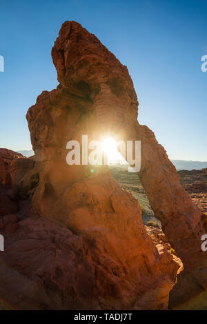 USA, Nevada, Redrock sandstone arch at sunrise in the Valley of Fire State Park - Stock Image