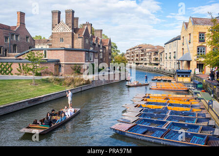 Cambridge, UK -  September 2018. Summer tourist punting on the river Cam, view from Magdalene bridge  with Magdalene College and Scudamore's Quayside  - Stock Image