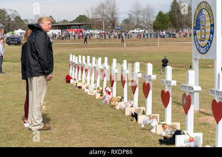 Opelika, Alabama, USA. 08th March, 2019. U.S President Donald Trump views crosses at a a makeshift memorial March 8, 2019 in Opelika, Alabama. The region was hit by a tornado on March 3rd killing 23 people. Credit: Planetpix/Alamy Live News - Stock Image