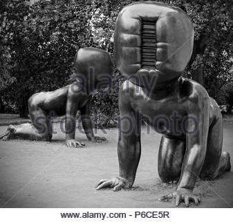 Large crawling bronze babies sculptures in front of the Museum of Modern Art in Kampa Park, ( Square - Black and White ) Prague, Czech Republic. - Stock Image