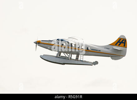 A De Havilland Canada DHC-3T Vazar Turbine Otter C-FHAA  departing the waterways  in Vancouver city harbour in British Columbia Canada. - Stock Image
