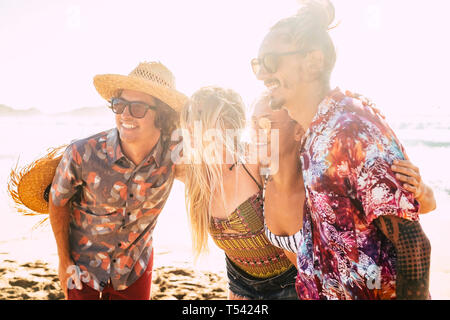Group of cute friends people hug together and pose for a picture smiling - cheerful pretty girls and boys youthful concept for summer vacation at the  - Stock Image