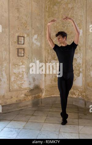 Cuba, Havana. Male dancer with ballet pose. Credit as: Wendy Kaveney / Jaynes Gallery / DanitaDelimont.com - Stock Image