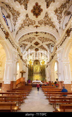 The nave in the interior of the Iglesia de Santiago (Church of Santiago), the oldest Roman Catholic church in Malaga, Andalusia, Spain Europe - Stock Image